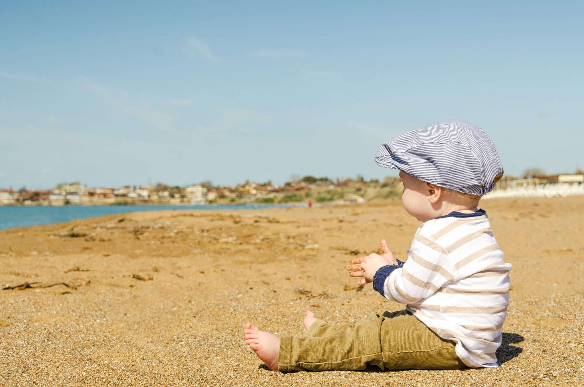 baby on holiday at beach